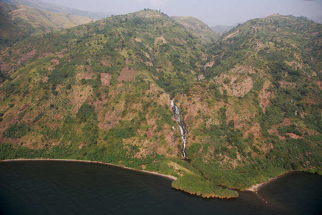 Photo MONUSCO/Abel Kavanagh Virunga National Park, North Kivu, DR Congo, 09 January 2015 : Partial view of a mountain range with a stream cascading down the valley before emptying into Lake Edward.